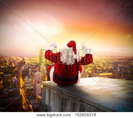 Santa Claus on a roof view city at dawn