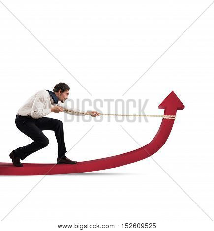 Determinated businessman with much effort lifts statistics arrow with a rope