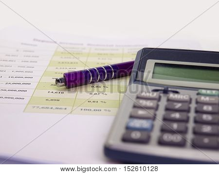 Business concept with account book pen and calculator White background.