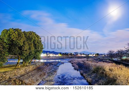 Stream at night in Kyoto Japan with moonlight and scenic landscape