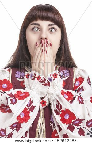 Natural Portrait of Frightened Caucasian Female. Posing with Hands Closing Mouth. Against Pure White. Vertical Image