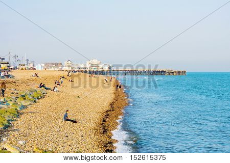 PORTSMOUTH UNITED KINGDOM - JUNE 06: This is Portsmouth main beach area where people com to sunbath and swim in the distance you can also see the pier on June 06 2016 in Portsmouth.
