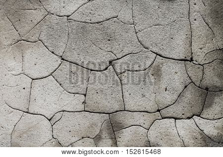 Old cracked grey wall background with grain