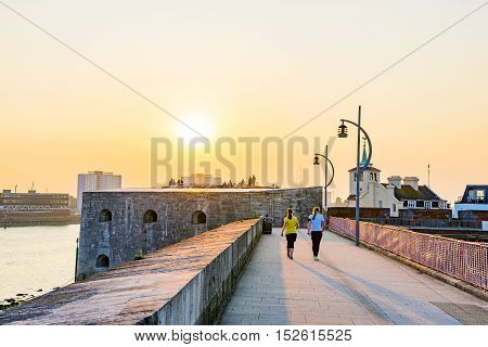 Walking path in Portsmouth castle area during sunset