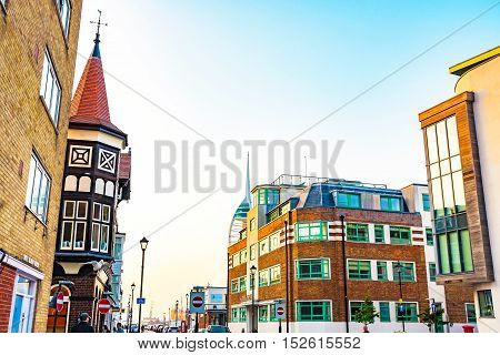 PORTSMOUTH UNITED KINGDOM - JUNE 06: Portsmouth downtown area where there are many expensive apartments and traditional English buildings on June 06 2016 in Portsmouth.