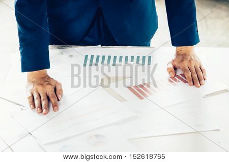 Close-up Of Business Man Put Hands On Financial Papers On Work Desk In The Business Meeting