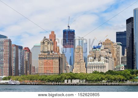 View of Lower Manhattan with the World Trade Center complex under construction.