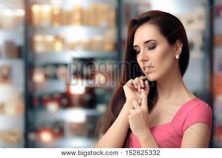 Beautiful Girl Testing Perfume in a Cosmetics Shop