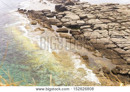 Sea rocks on the shore, background textures