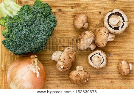 Top Down View On Mushrooms, Broccoli And Onion