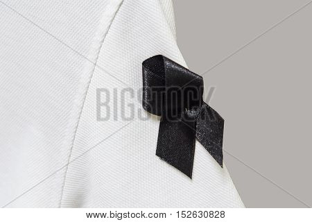 Mourn ribbon at Sleeve of white shirt