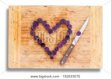 Purple Carrots Arranged As A Heart