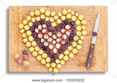 Chopped Carrots In The Shape Of A Heart With Knife