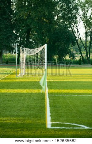 left side view of standard goal and net in football pitch or soccer field sport equipment in the stadium