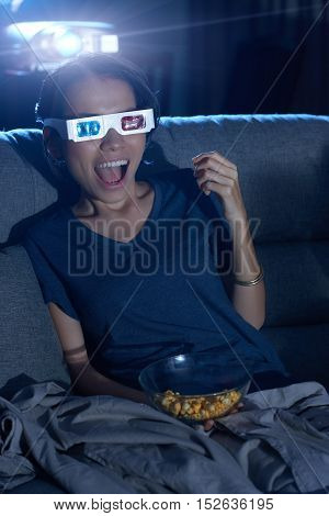 Young woman excited with 3D effects in a movie