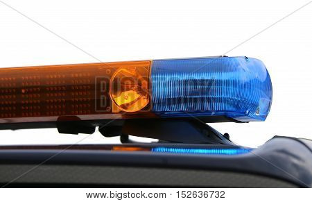 Orange And Blue Flashing Lights Of The Police Car