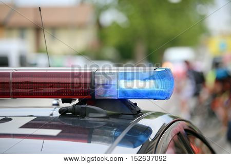 Blue Flashing Lights Of The Police Car At A Sports Event