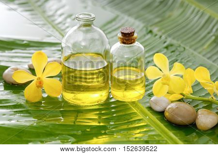 Spa set on banana leaf with pebbles,oil