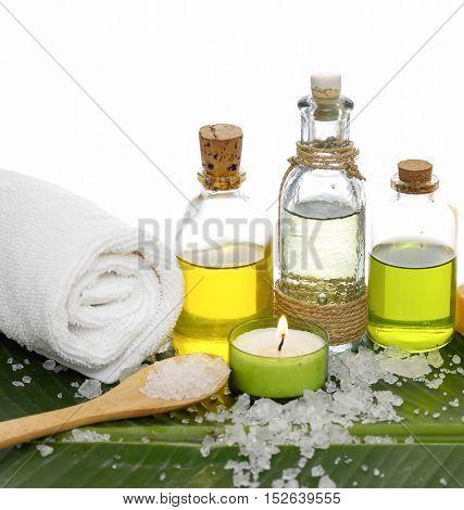 Spa set on banana leaf with pile of salt