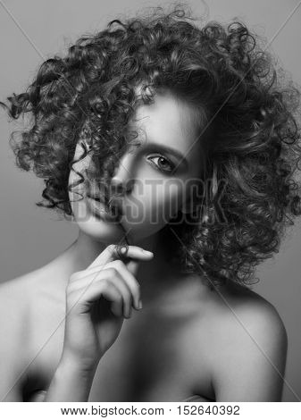 Beautiful Young Woman with Curly Hair. Healthcare and beauty concept