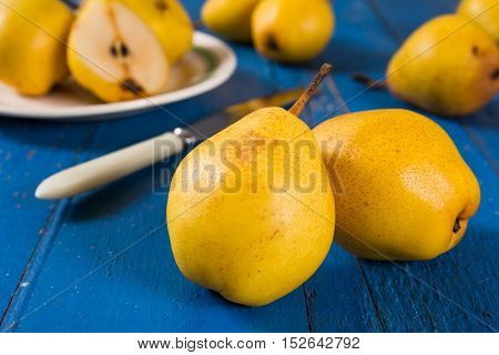 Juicy pears, fresh ripe organic pears on blue rustic wooden table, natural background, organic pears, diet food.