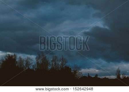 storm clouds over the forest. gloomy sky over silhouette of the forest