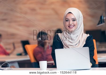 Young Arabic Business Woman Wearing Hijab,working In Her Startup Office. Diversity, Multiracial Conc