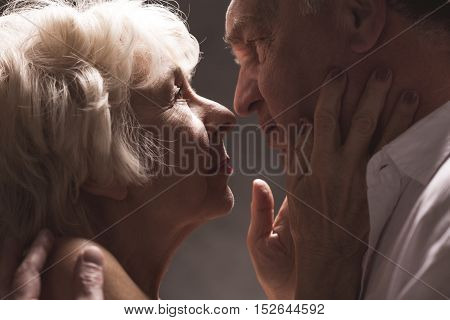 Close-up Of Senior Couple Kissing