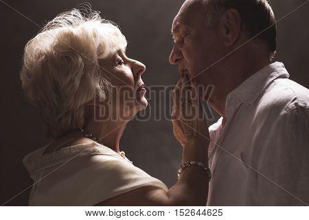 Senior Woman Touching Husband's Lips