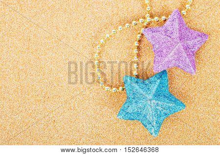 Star glitter decorate for christmas on golden background.