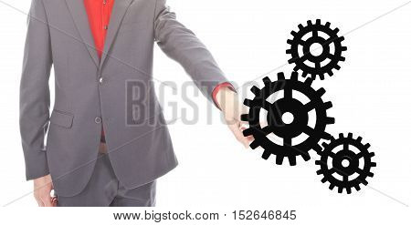 Young businessman with gears on white background