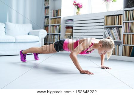 Workout. Woman exercise at home