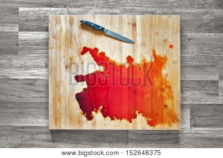 Blood and knife on the big wooden cutting board