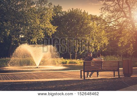 Vintage photo of a peaceful park in sunset