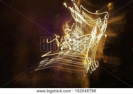 Light Motion With Slow Speed Shutter, Street Lights In Speeding Car In Night Time. Abstract Light Ba