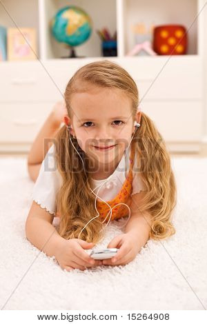 Little Girl Listening To Portable Music Device