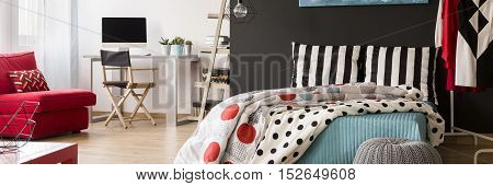 Spacious multifunctional bedroom interior with comfortable work space