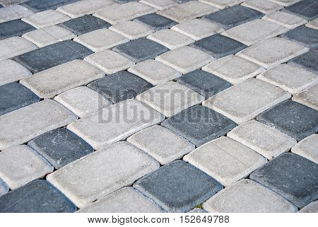 Urban road is paved with blocks of stone