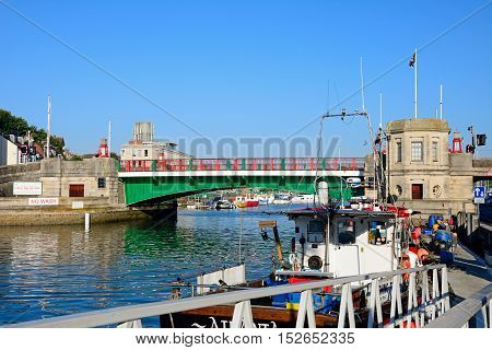 WEYMOUTH, UNITED KINGDOM - JULY 19, 2016 -View of the twin leaf bascule bridge and boats in the harbour Weymouth Dorset England UK Western Europe, July 19, 2016.