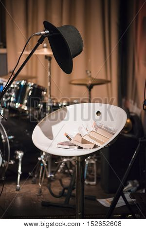 Music club microphone hat, book on the chair drum set