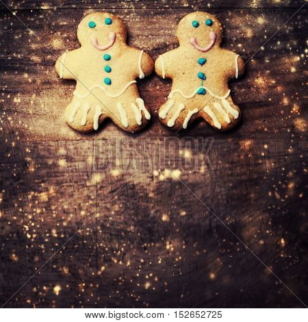 gingerbread man cookie with copyspace and festive glitter