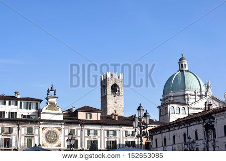 Skyline of Square della Loggia in Brescia with the dome of the Cathedral in the background - Italy