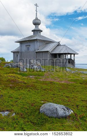 Old wooden church on the beach. Religion architecture history
