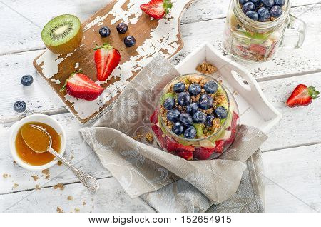 Granola And Berries In Glass Jar For Healthy Breakfast.  Healthy Eating And Diet Concept. Top View