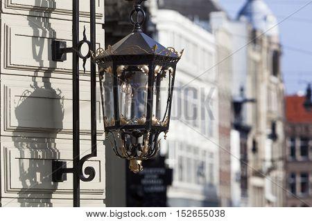 Classical lantern in a street in Amsterdam