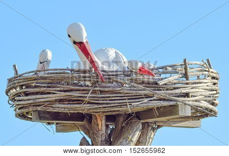 Toy Nest Of A Stork With Birds On It