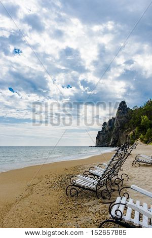 Waves during a storm on lake Baikal, pour left on the beach chair.