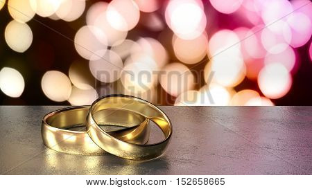 Two golden wedding rings on a grey stone table in front of a shiny bokeh background in different autumn colors 3D illustration