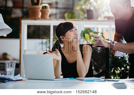 Professional Employees Discussing Ideas Of Project On Laptop