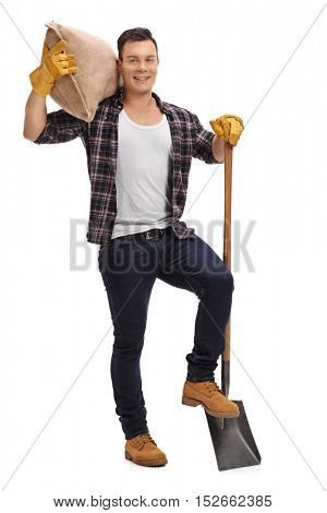 Full length portrait of a male agricultural worker posing with a shovel and a burlap sack isolated on white background